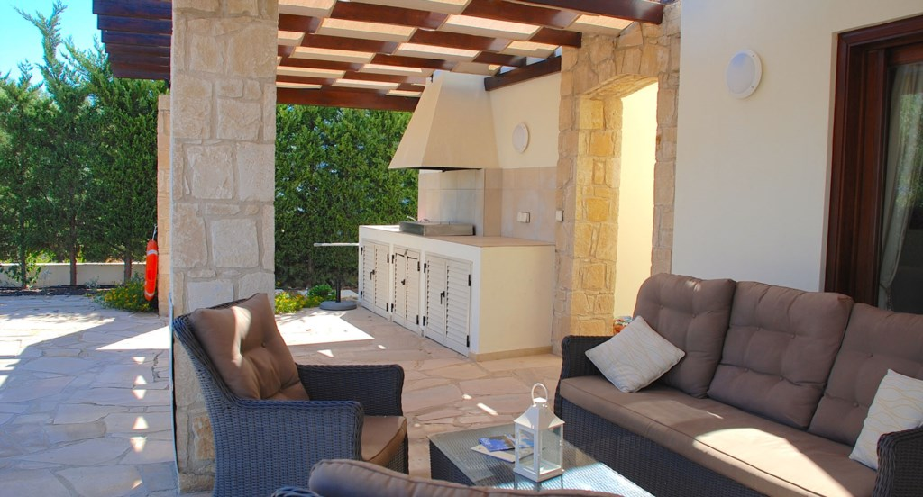 Villa 252 - Comfortable seating and built in BBQ area. Aphrodite Hills Resort, Cyprus.