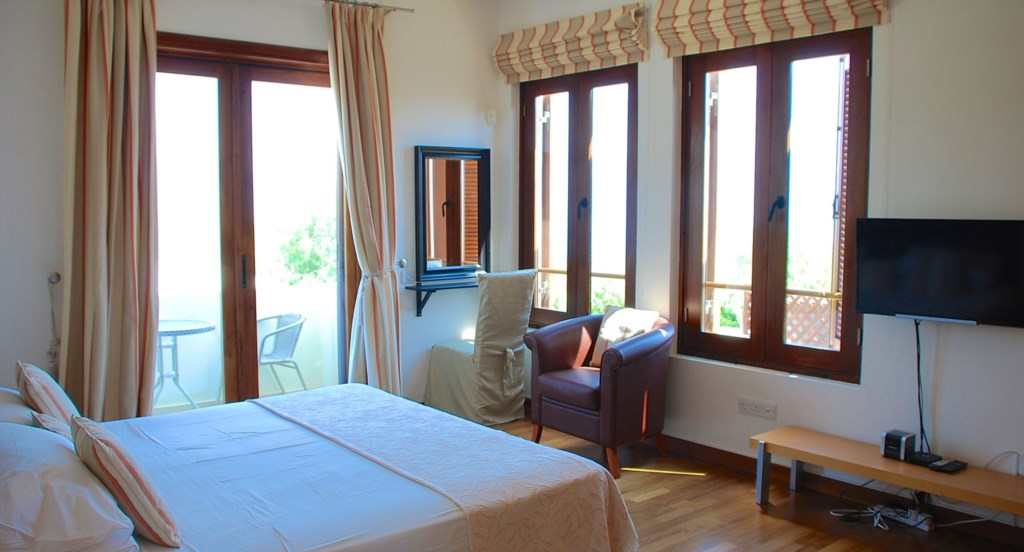 Villa 252 - Large spacious master bedroom with pool and sea views. Villa 252 - Separate living area.