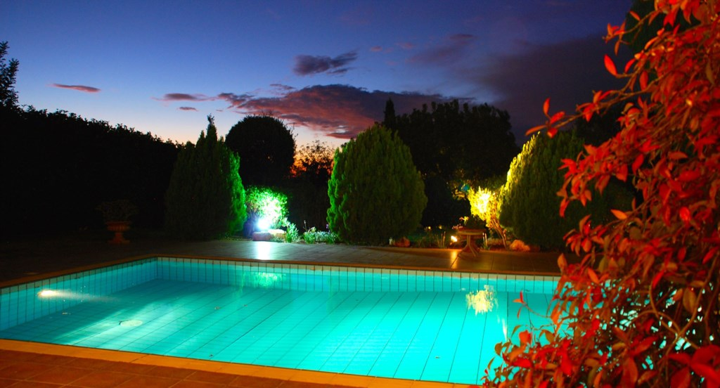 Villa 64 - Sneaking a peak over the garden at night. Aphrodite Hills Resort, Cyprus.