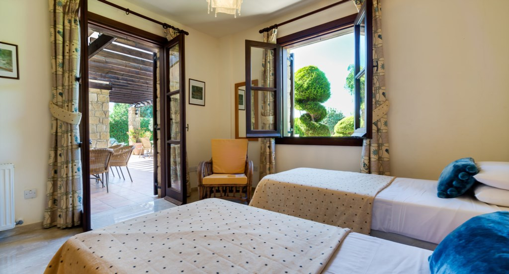 Villa 64 - Ground floor twin room opening out to the terrace. Aphrodite Hills Resort, Cyprus.