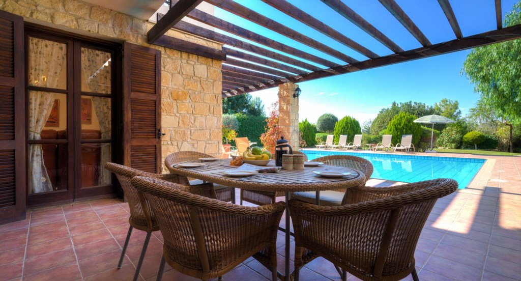 Villa 64 - Dining outside overlooking the pool and garden. Aphrodite Hills Resort, Cyprus.