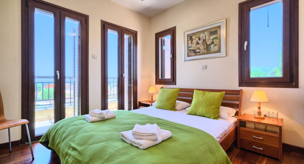 Apartment E11 - Second bedroom with balcony and en suite. Aphrodite Hills Resort, Cyprus.