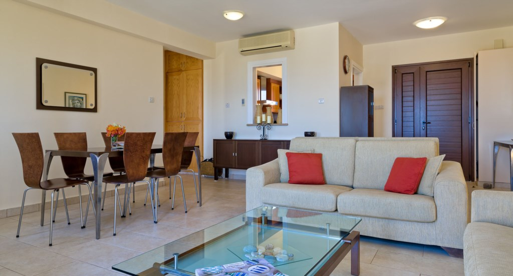 Apartment E11 - Open plan kitchen, living and dining area. Aphrodite Hills Resort, Cyprus.