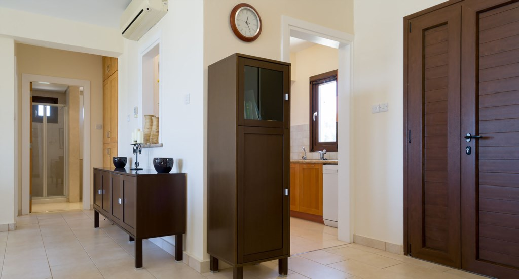 Apartment E11 - View of the kitchen, and hallway to second bedroom with en suite bathroom. Aphrodite
