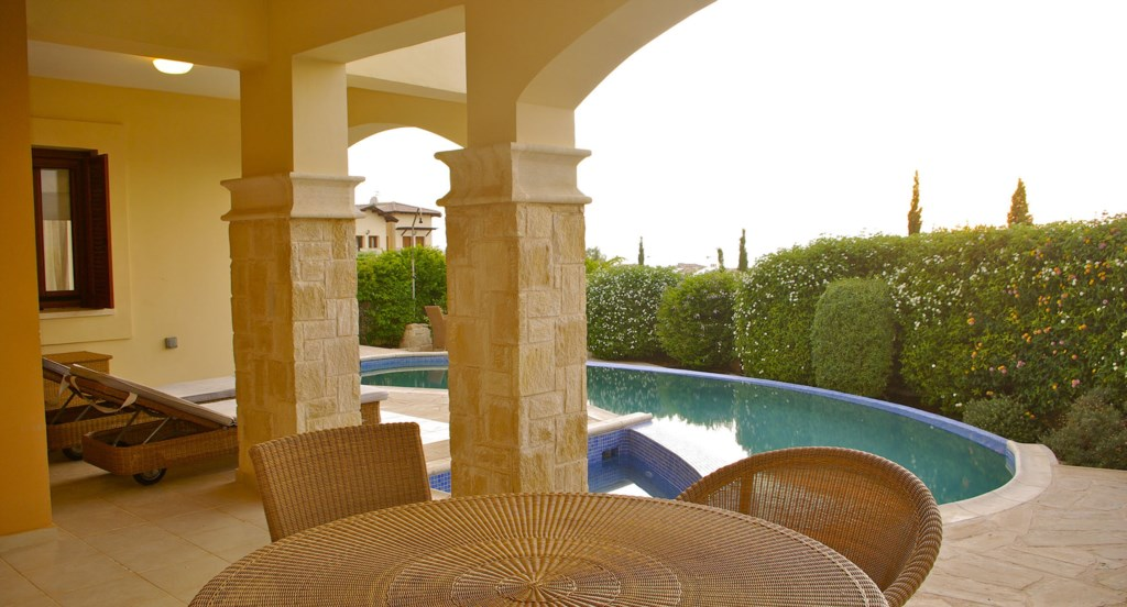 Apartment Hemera - Dining table, outside chairs and swing chair on the terrace. Aphrodite Hills Reso