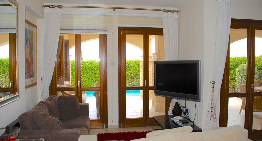 Apartment Hemera - Lovely living area overlooking the pool. Aphrodite Hills Resort, Cyprus.