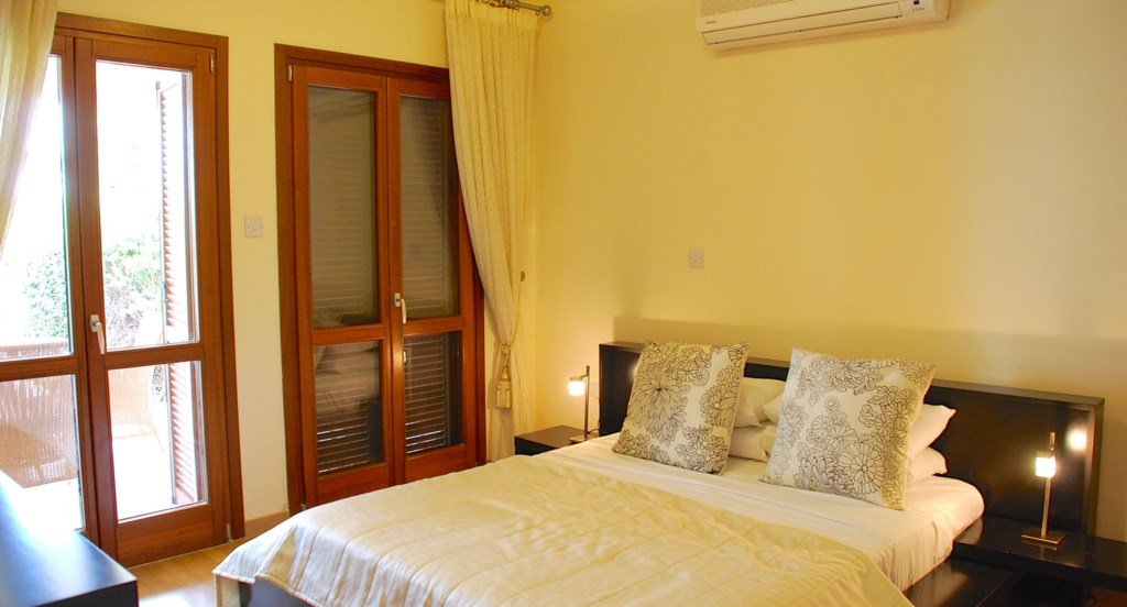 Apartment Hemera - Lovely master bedroom opening out to outside terrace. Aphrodite Hills Resort, Cyp