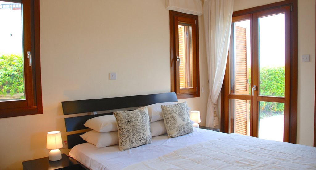 Apartment Hemera - Second double room, opening out to terrace. Aphrodite Hills Resort, Cyprus.