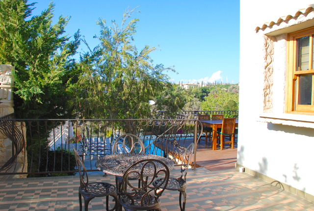 Villa 305 - Side terrace, perfect for reading your paper with morning coffee. Aphrodite Hills Resort