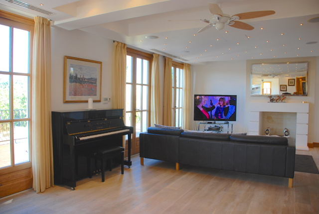 Villa 305 - Gorgeous living area with feature lighting and piano. Aphrodite Hills Resort, Cyprus.
