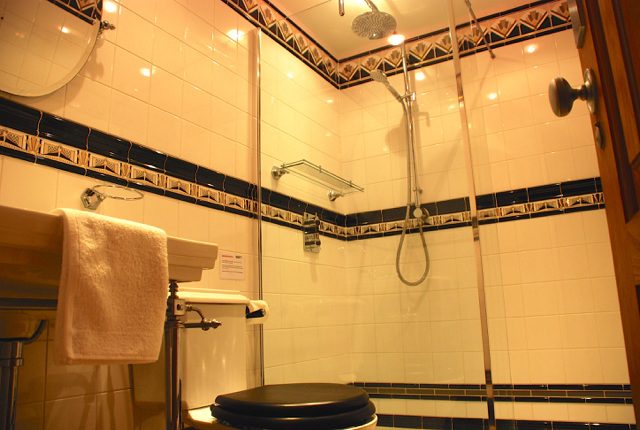 Villa 305 - Lower level shared bathroom with power shower. Aphrodite Hills Resort, Cyprus.