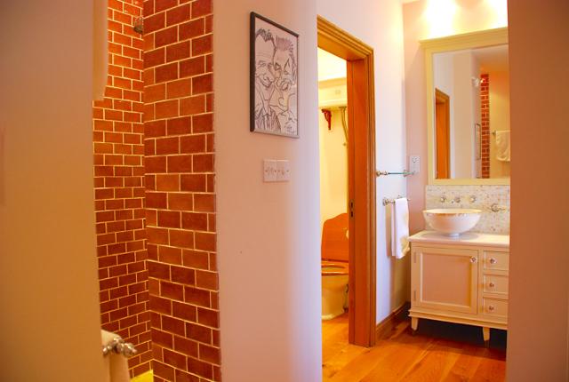 Villa 305 - Master bedroom wet room shower, WC and bath area. Aphrodite Hills Resort, Cyprus.