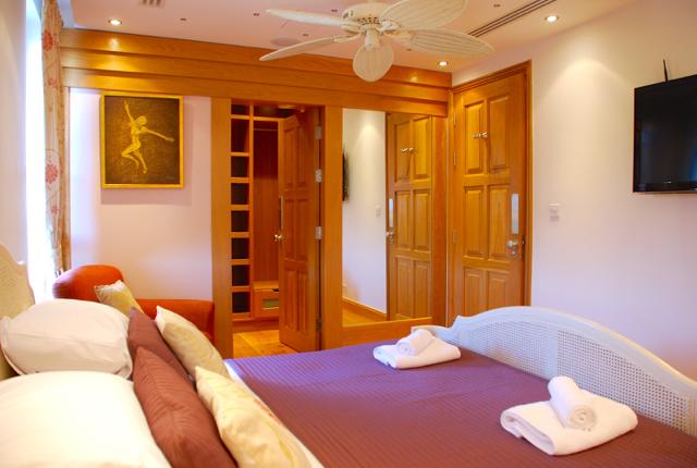 Villa 305 - Master bedroom with walk in wardrobe. Aphrodite Hills Resort, Cyprus.
