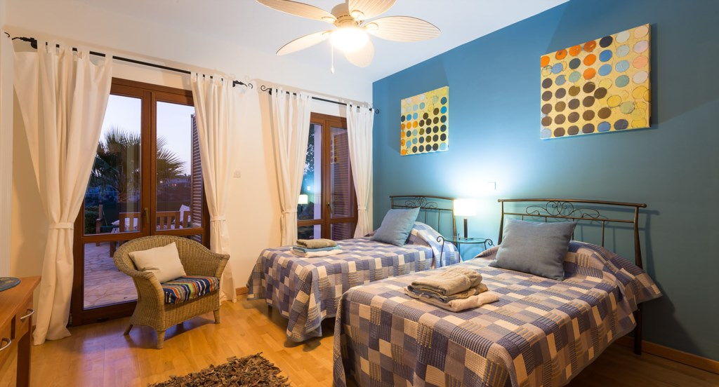 Villa Anthos - bedrooms are very inviting by night