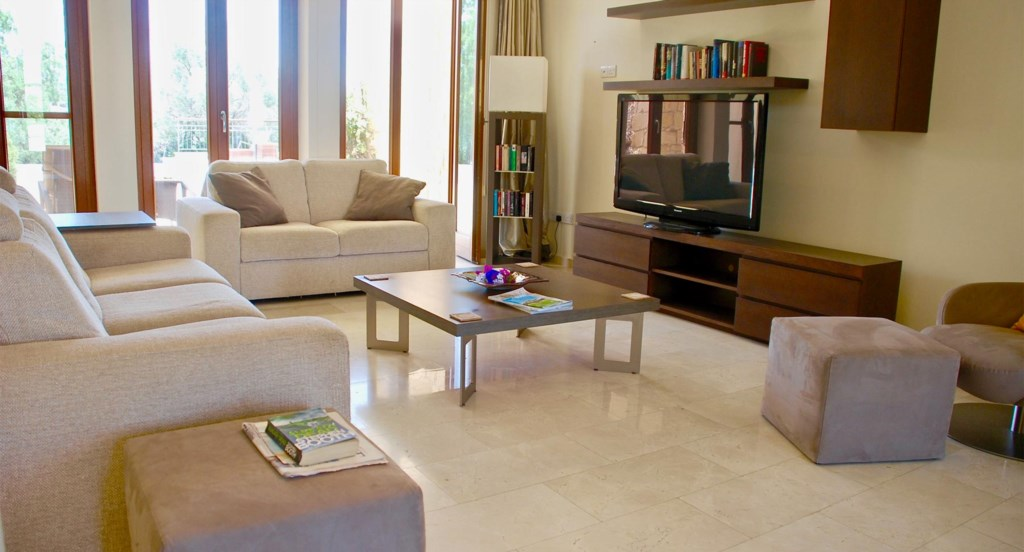 Villa 230 - Comfortable living area with HD TV and UK channels. Aphrodite Hills Resort, Cyprus.
