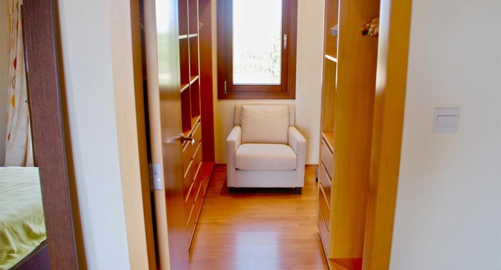 Villa 230 - Master bedroom with walk-in wardrobe. Aphrodite Hills Resort, Cyprus.