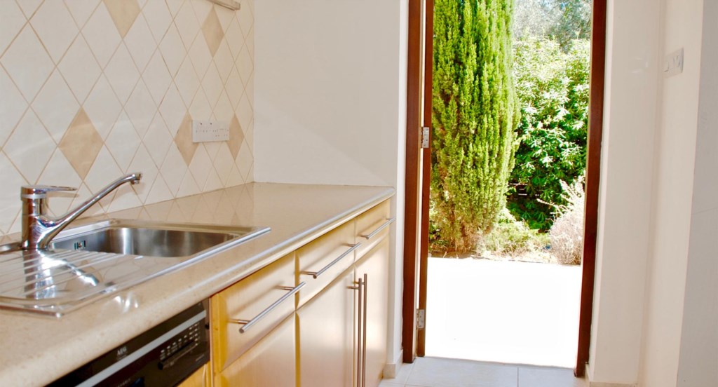 Villa 230 - Fully-fitted, wooden kitchen. Aphrodite Hills Resort, Cyprus.