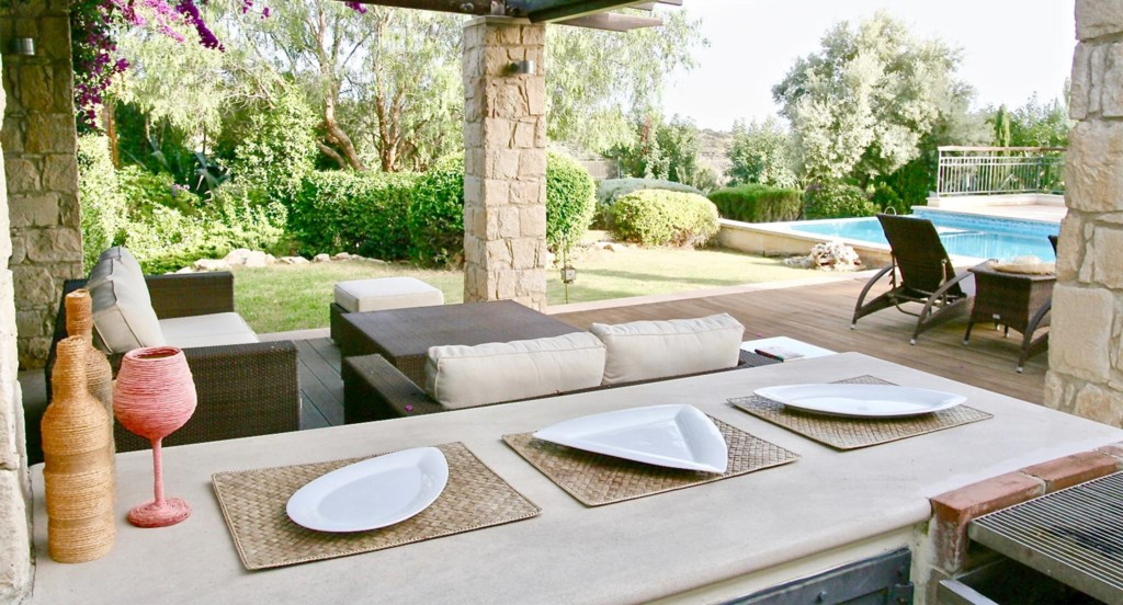 Villa 230- Lovely terrace with dining space, seating, and stunning views. Aphrodite Hills Resort, Cy