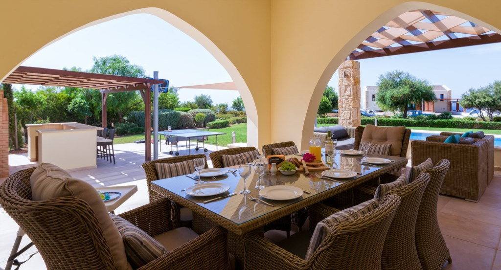 Villa 350 - Al fresco dining overlooking the pool and garden. Aphrodite Hills Resort, Cyprus.