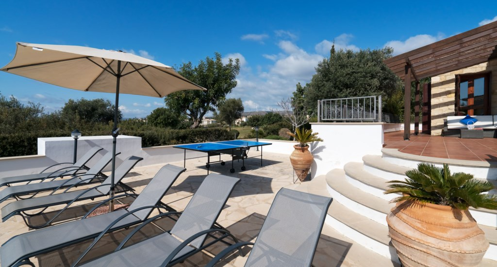 Villa 395 - Kick back and soak up the sunshine in the garden. Aphrodite Hills Resort, Cyprus.