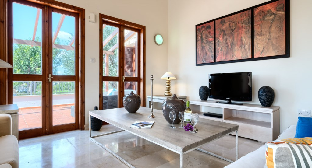 Villa 395 - Comfortable living area with UK TV. Aphrodite Hills Resort, Cyprus.