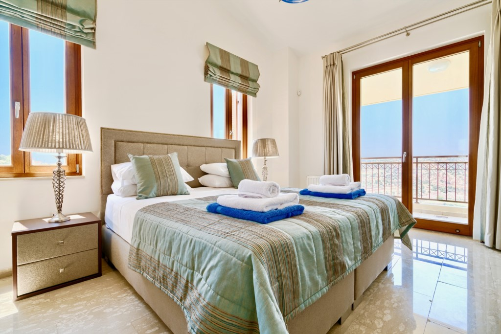 Villa 15 - Stunning master bedroom with lovely views. Aphrodite Hills, Cyprus.