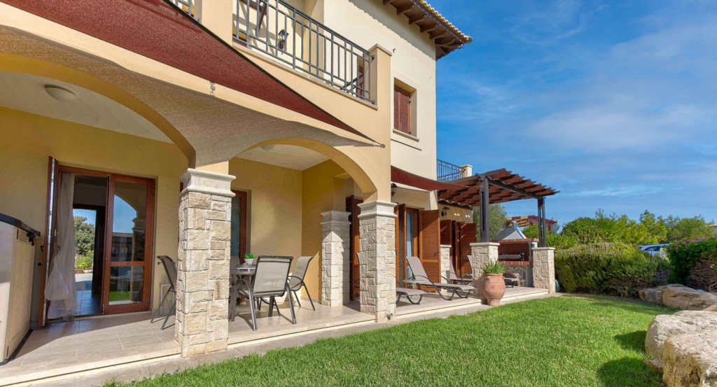 19. Luxury holiday apartment Aphrodite Hills Resort Cyprus_Garden Side 1.jpg