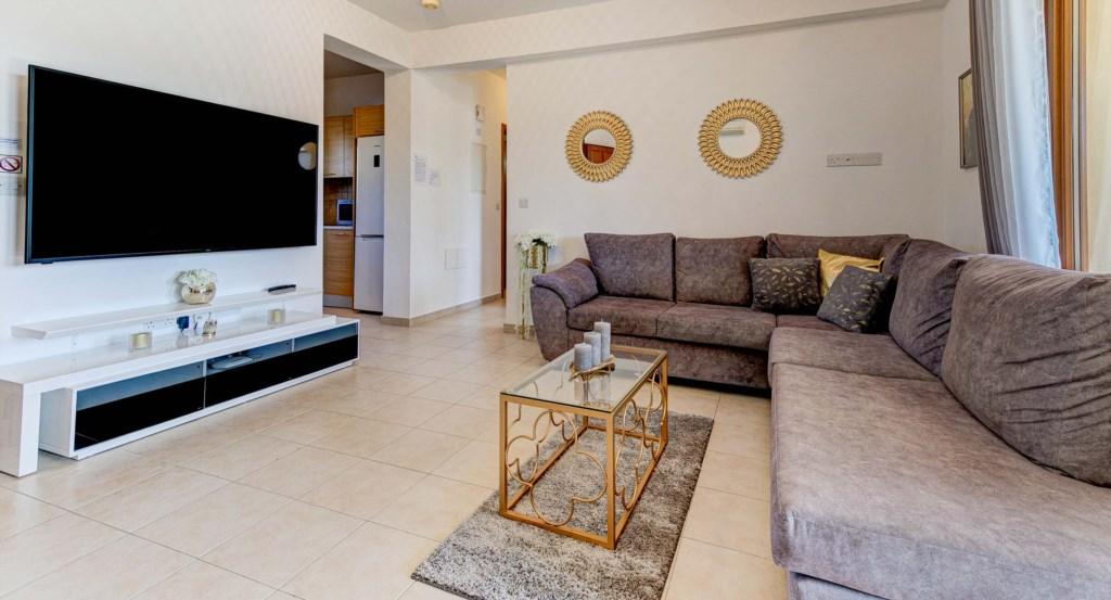 3. Luxury holiday apartment Aphrodite Hills Resort Cyprus_Living Room 2.jpg