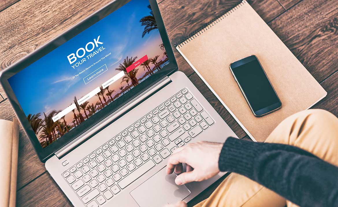 person booking vacation on computer