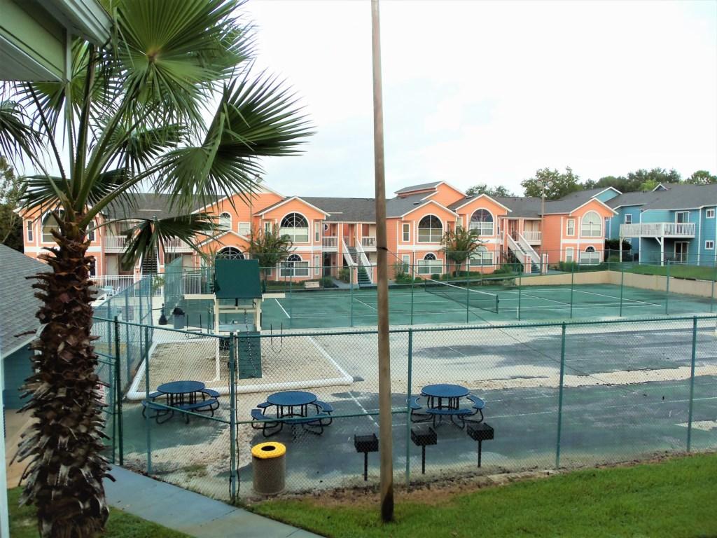 Island Club bbq area & tennis courts