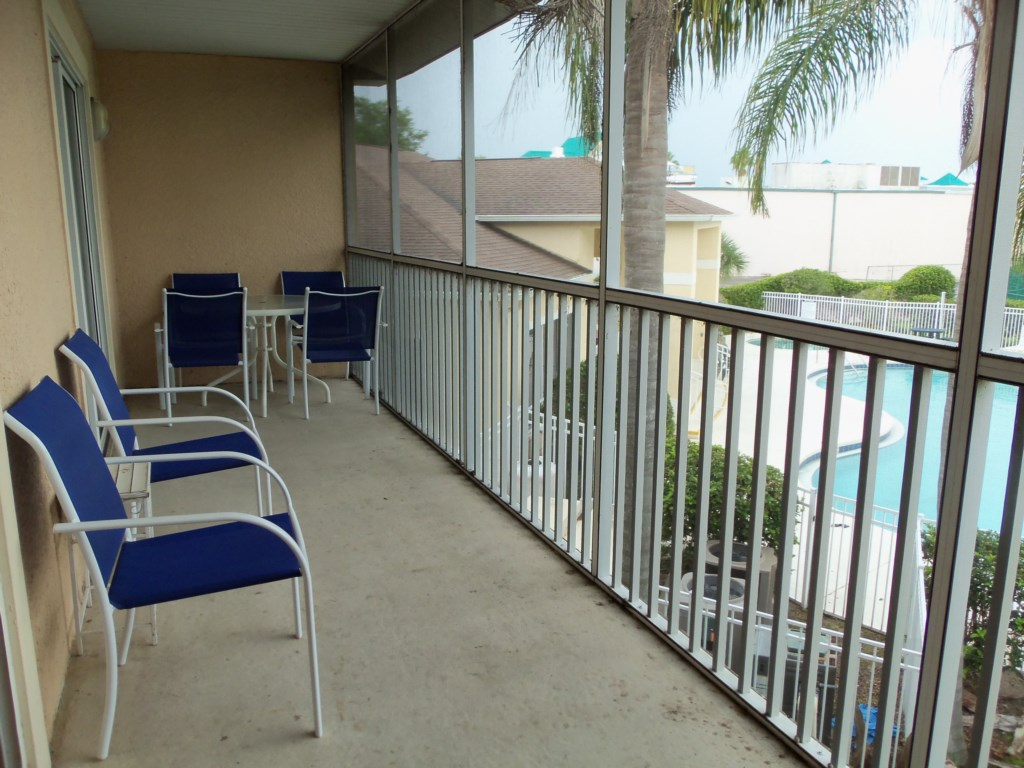 Screened-in balcony with seating for 8