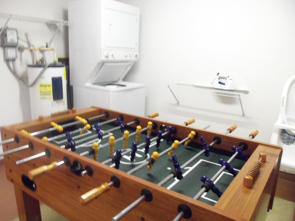 In unit washer and dryer plus fooseball table