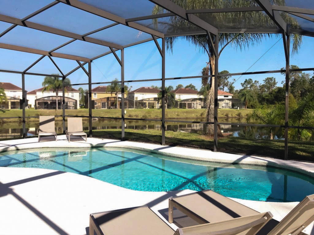 Large Pool with beautiful water views! Plenty of loungers!