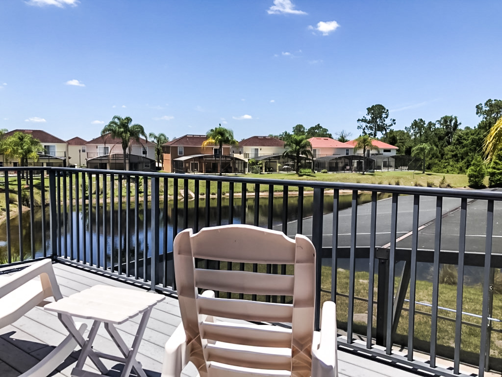 Master Bedroom Private Patio, 2nd floor overlooking pond, 2 rocking chairs!
