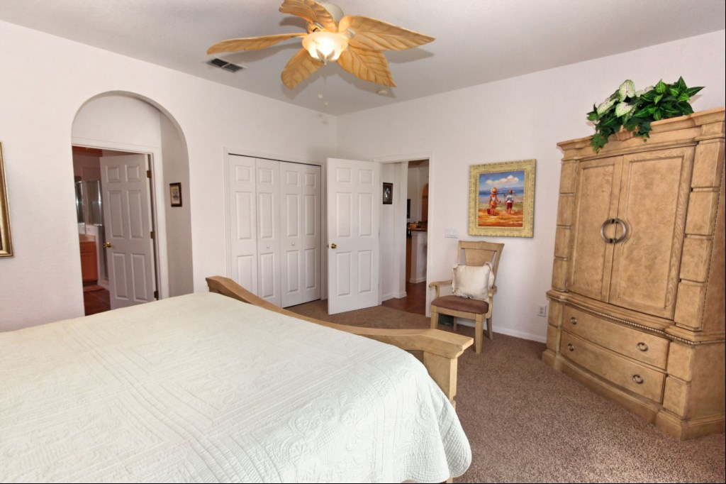 Master bedroom with direct access to pool deck - TV in cabinet