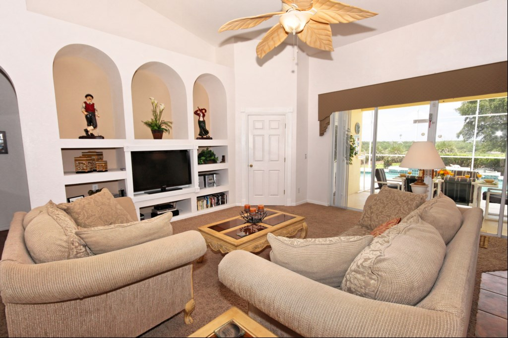 Family room with direct access to pool deck