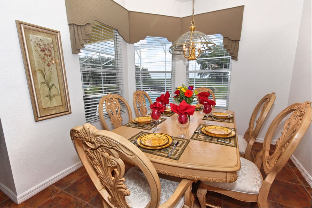 Dining room seating for 6 with views over pool deck