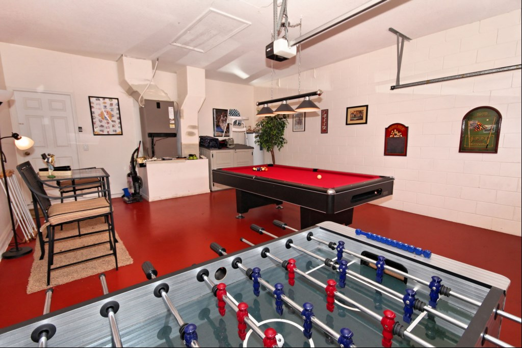 Games room with bar table and stools while you wait your turn