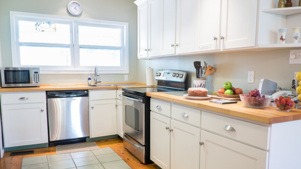 Fully stocked kitchen with butcher block counters - Butterfly Cottage - Niagara-on-the-Lake