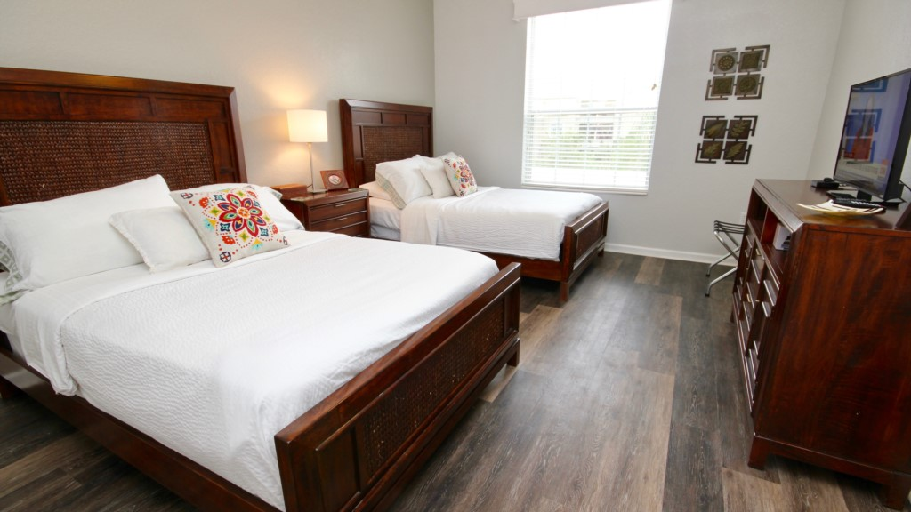 Second guest bedroom with 2 double beds