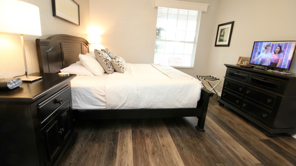 Spacious guest bedroom with king bed