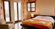Villa 230 - Master bedroom with balcony. Aphrodite Hills Resort, Cyprus.