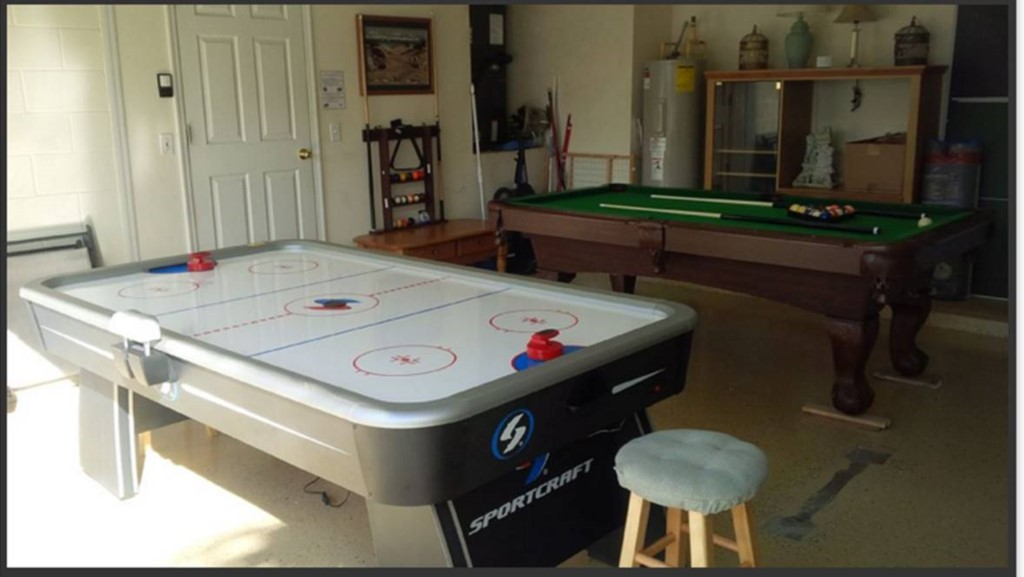 Games Room includes Pool Table, Air Hockey, Ping Pong Table Top, Pub Table and Couch. A Washer and D