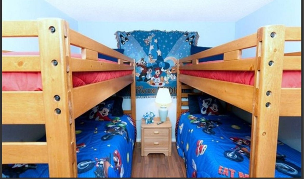 Child themed room with Double bunk beds, TV, VCR, and Disney Movie Library