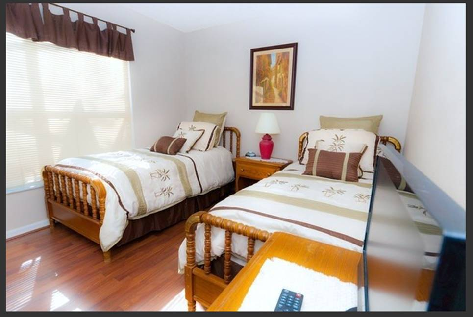 Fourth Bedroom with Twin Beds and HDTV. All bedrooms have laminate flooring.