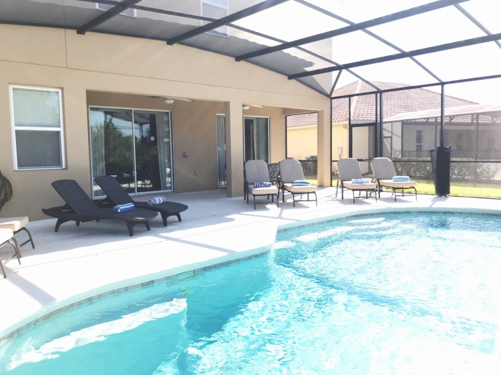 Extended lanai, several loungers and a 6 person patio set!