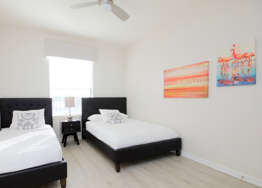 Guest bedroom with one double and one single bed