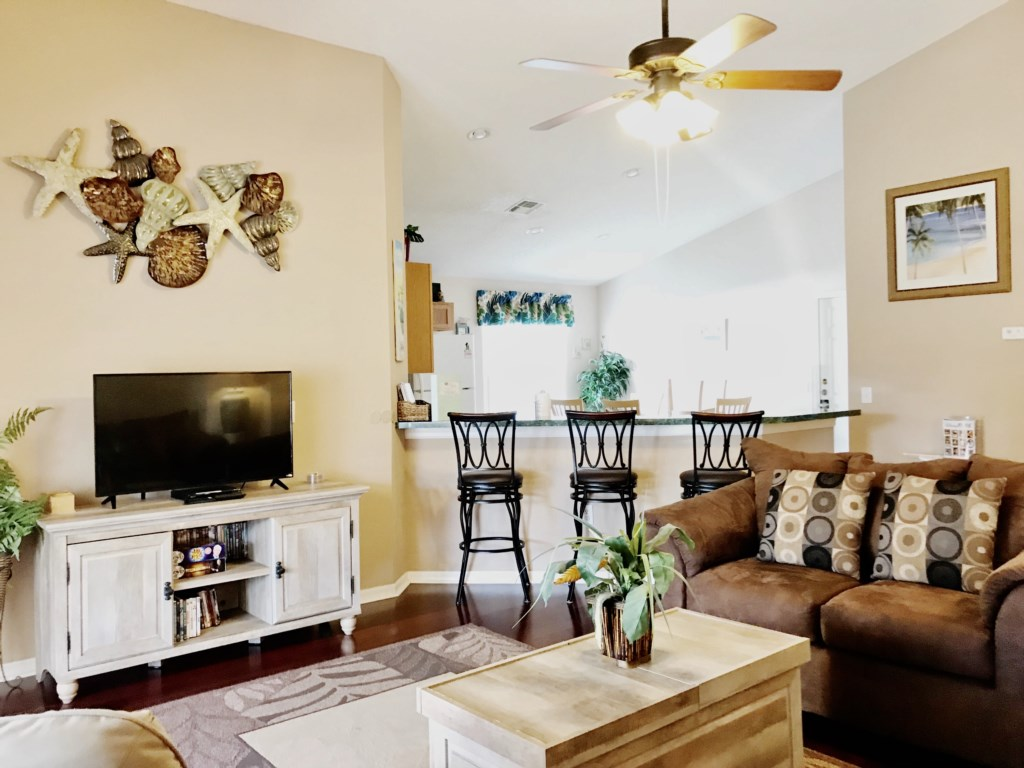Living Room Leads to the Open Concept Kitchen - Flat Screen TV!