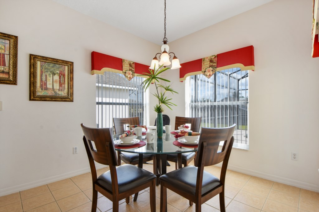 Family Kitchen Table for 4! Great views of the pool and neighborhood!
