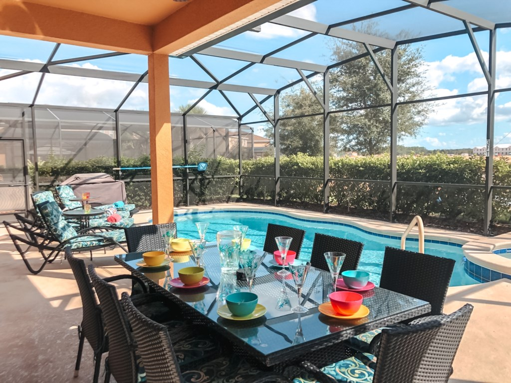 Enjoy al fresco dining under the lanai for 8 and a BBQ for your use!